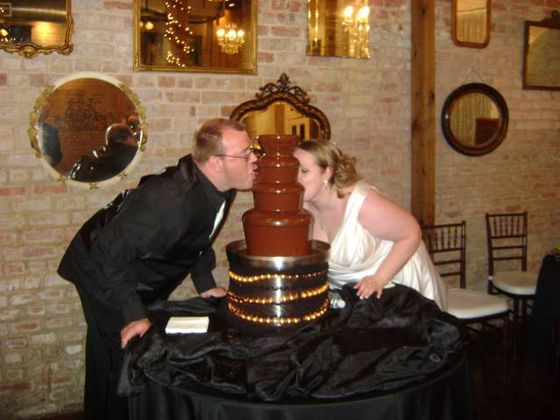 Bride and Groom Enjoying a Chocolate Fountain